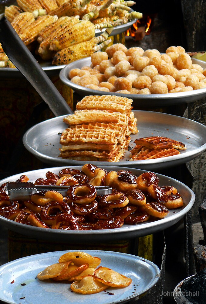 Delicious snacks in Phnom Penh's Russian Market by John Mitchell