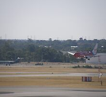 Virgin Blue Plane Landing. Perth International Airport. by m004