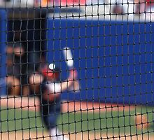 Softball - Blurred Batter Seen throught the Backstop Net by Buckwhite