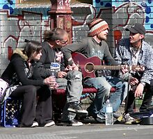 Buskers in Brunswick street, Melbourne. by John Mitchell