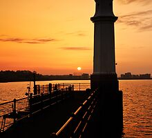 Newhaven Lighthouse Sunset by David Queenan