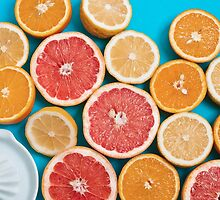 Juicy citruses on a blue table by Anna Alferova