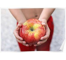 Child holding large red apple Poster