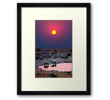 SUNSET WITH RHINOS Framed Print