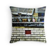 The red wheel above the red grate Throw Pillow