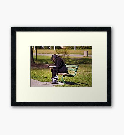 Studying Framed Print