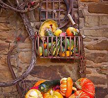 Fruit in a basket by Hans Kawitzki
