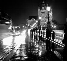 A view towards Tower Bridge from the Tower of London on a damp March Night. by Paul  Brewer