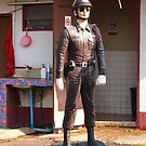 cop on a pedestal by OTOFURU