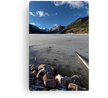 Frozen Smith and MoreHouse reservoir in Utah with log  Canvas Print