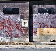 Old Garage Doors - Somebody Lives Here by M Sylvia Chaume