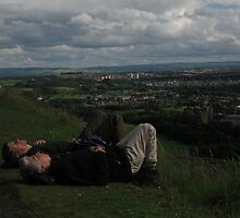 Hikers...well nappers in Edinburgh, Scotland by Rich Clark