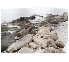 Some rocks on the beach Poster