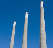 Energy - Three Smoke Stacks on a Blue Sky by Buckwhite