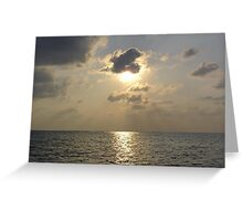 Sun shining from behind a cloud at near sunset off the waters of the Lakshadweep Islands Greeting Card