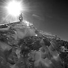 Snowboarder on top of a snowy mountain by Vegard Giskehaug