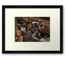 Spooky faces in a stream Framed Print