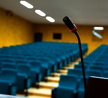 Microphone in an empty auditorium by mrfotos