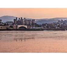 Conwy Castle and harbour at dusk Photographic Print