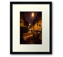 Couch in the street Framed Print