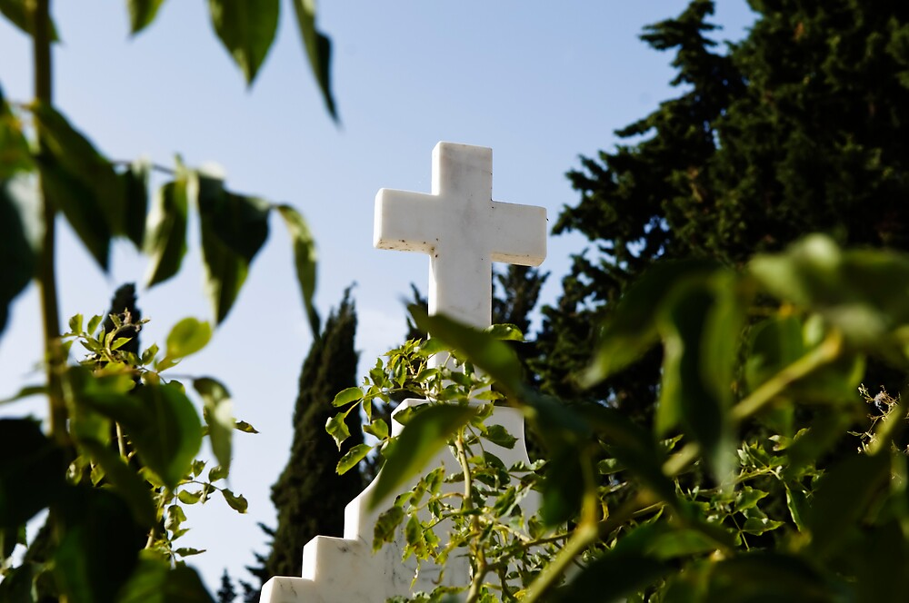 Stone cross in a catholic cemetery, Portugal by mrfotos