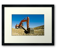 Excavator in a road construction Framed Print