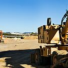 Excavators in a road construction site by mrfotos