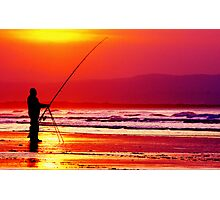 Fisherman Silhouette against the setting sun on downhill beach Ireland Photographic Print
