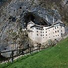 Predjama Grad With Foreground Jousting Ground in Slovenia by jojobob