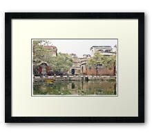 Village by the pond Framed Print