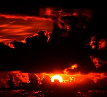 dark moody red sunset sky by morrbyte