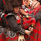 Scottish Pipers tuning up - Ironfest 2009 by Julie Sherlock