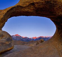 Lone Pine Mountains Painted With Light View through Arch Rock by photosbyflood