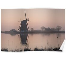 Sunrise over a cold and misty windmill Poster