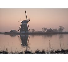 Sunrise over a cold and misty windmill Photographic Print