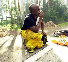 Firefighter needs oxygen by Larry  Grayam