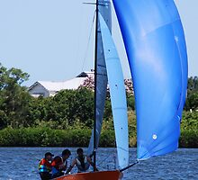 Orange Boat Blue Sail by Graham Mewburn