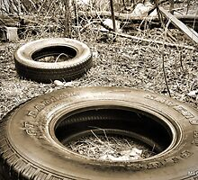 Tires in a Vacant Lot Sepia Gold Tones by M Sylvia Chaume