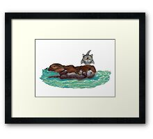 Sea Otter Nibbles on a Crab as Kitten Watches  Framed Print