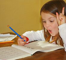 Young girl doing homework with pleasure. by gregorydean