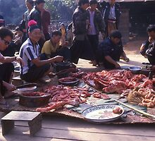 Preparing for the feast at a wedding of the Hmong Tribe. Northern Thailand. by Peter Stephenson
