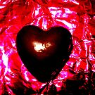 Chocolate Heart on Pink Foil by blueclover