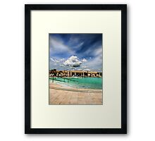 clouds over the swimming pool Framed Print