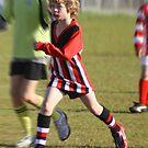 My nephew playing football by John Hansen