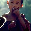 Karen boy smoking cheroot by John Spies