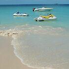 Jet skis at beach on Antigua, West Indies by John  Lambert