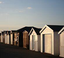 Beach huts at sunset by Sarah Howlett