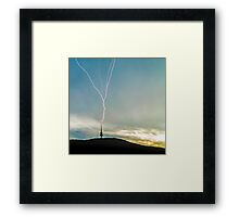 Lightning Strikes Tower During Storm Framed Print