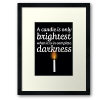A candle is only brightest in complete darkness Framed Print
