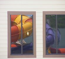 Reflection in a window of slides at Salamander Springs outdoor waterpark by raindancerwoman